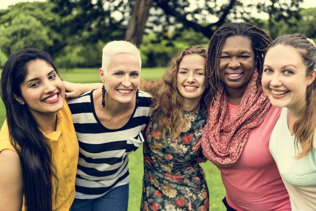 65479036 - group of women socialize teamwork happiness concept